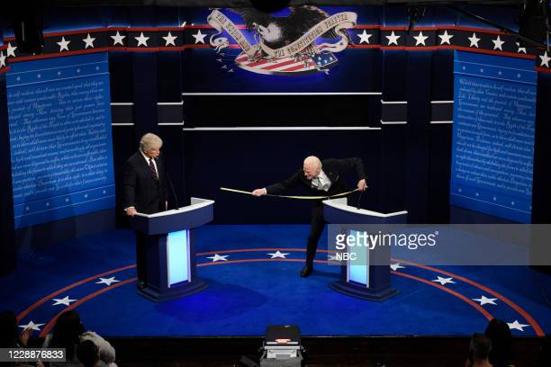 """Chris Rock"""" Episode 1786 -- Pictured: Alec Baldwin as Donald Trump and Jim Carrey as Joe Biden during the """"First Debate"""" Cold Open on Saturday,..."""