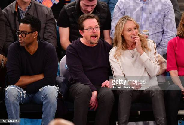 Chris Rock Michael J Fox and Tracy Pollan attend the Oklahoma City Thunder Vs New York Knicks game at Madison Square Garden on December 16 2017 in...