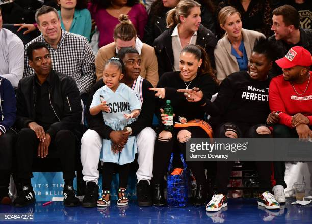 Chris Rock Tracy Morgan Maven Morgan Megan Wollover and Leslie Jones attend the New York Knicks Vs Golden State Warriors game at Madison Square...
