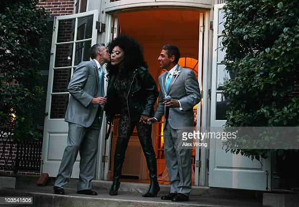 Chris Roe kisses entertainer Xavier Onassis Bloomingdale who dresses as a drag queen as Roe's newly wedded husband and TV reporter Roby Chavez looks...
