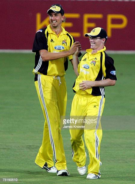 Chris Rogers and Brett Dorey of the Warriors celebrates after dismissing Mark Cosgrove of the Redbacks during the Ford Ranger Cup match between the...