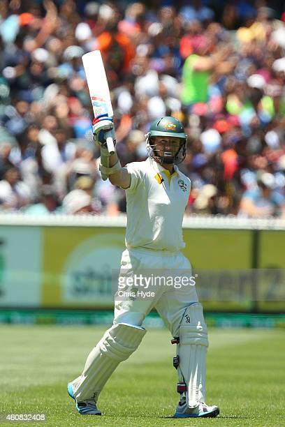 Chris Rogers of Australia celebrates a half century during day one of the Third Test match between Australia and India at Melbourne Cricket Ground on...