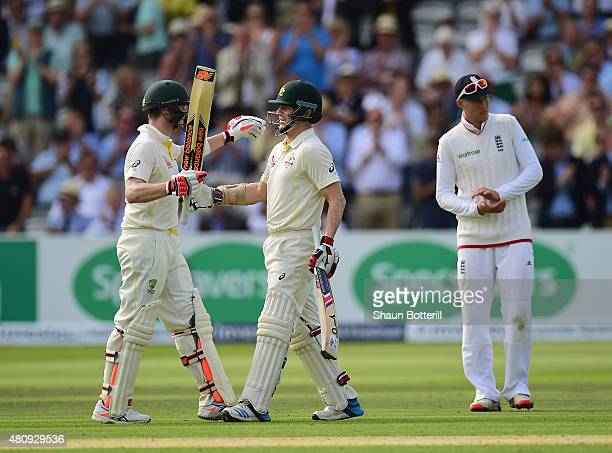 Chris Rogers of Australia celebrates his century with teammate Steve Smith as Joe Root of England applauds during day one of the 2nd Investec Ashes...