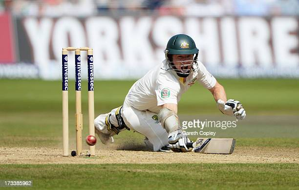 Chris Rogers of Australia dives to make his ground during day four of the 1st Investec Ashes Test match between England and Australia at Trent Bridge...
