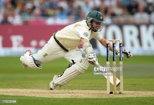 Chris Rogers of Australia dives to make his ground during day one of the 1st Investec Ashes Test match between England and Australia at Trent Bridge...