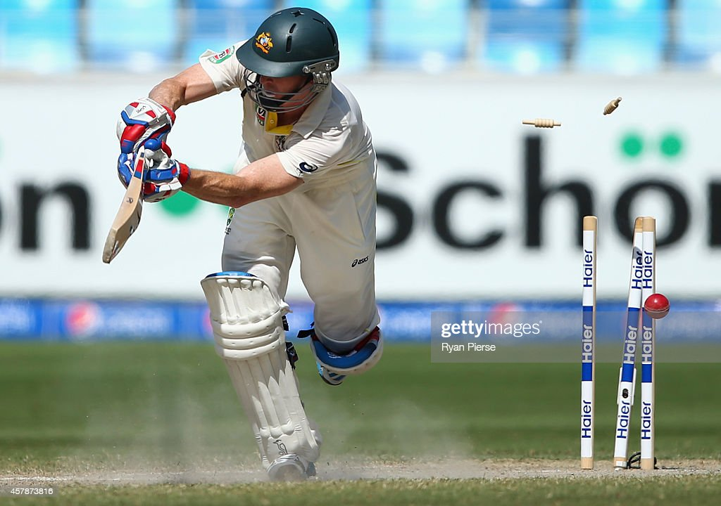 Chris Rogers of Australia is bowled by Imran Khan of Pakistan during Day Five of the First Test between Pakistan and Australia at Dubai International Stadium on October 26, 2014 in Dubai, United Arab Emirates.