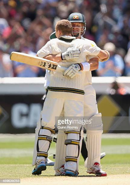 Chris Rogers of Australia is hugged by Shane Watson after making 100 runs during day four of the Fourth Ashes Test Match between Australia and...