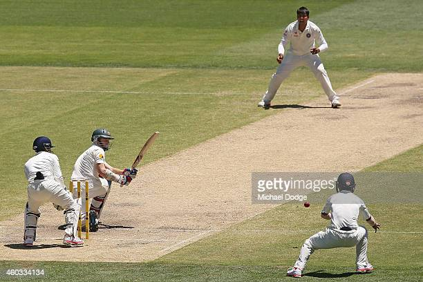 Chris Rogers of Australia plays a sweep shot against Karn Sharma of India during day four of the First Test match between Australia and India at...