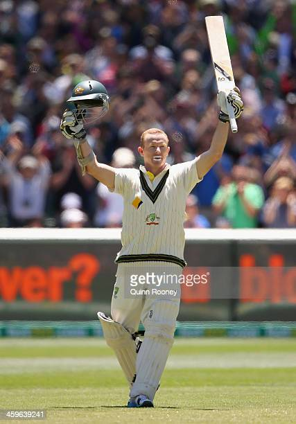 Chris Rogers of Australia raises his bat after making 100 runs during day four of the Fourth Ashes Test Match between Australia and England at...