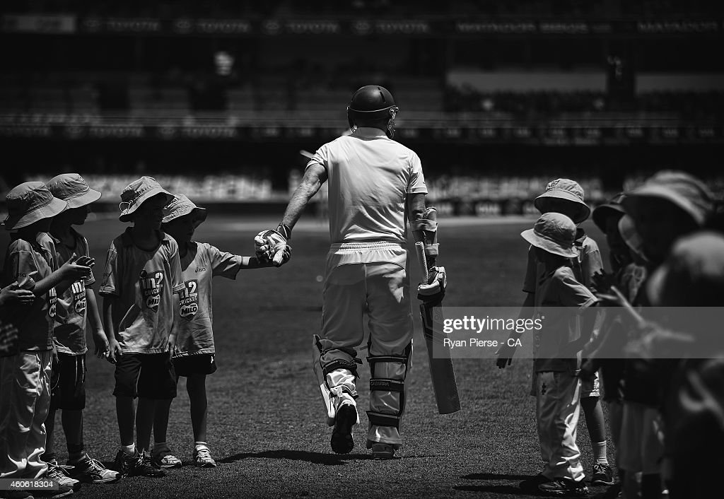 Chris Rogers of Australia walks out to bat during day two of the 2nd Test match between Australia and India at The Gabba on December 18, 2014 in Brisbane, Australia.