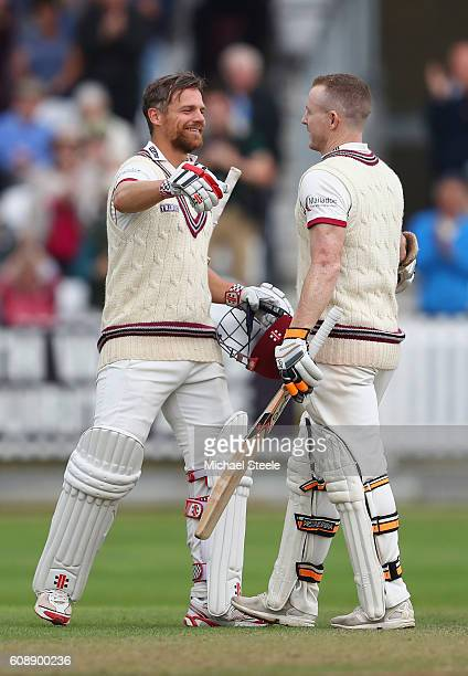 Chris Rogers of Somerset celebrates reaching his century with James Hildreth during day one of the Specsavers County Championship Division One match...