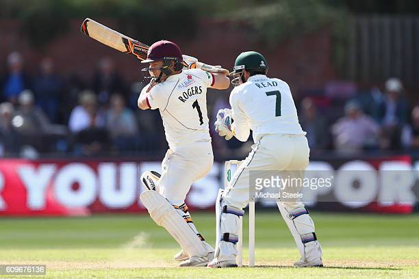 Chris Rogers of Somerset hits to the offside as wicketkeeper Chris Read of Nottinghamshire looks on during day three of the Specsavers County...