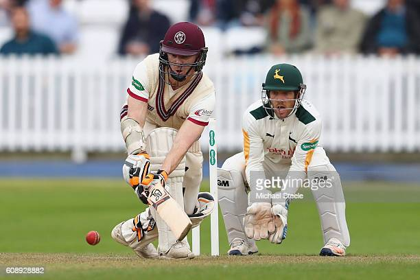 Chris Rogers of Somerset sweeps a delivery from Samit Patel as wicketkeeper Chris Read looks on during day one of the Specsavers County Championship...