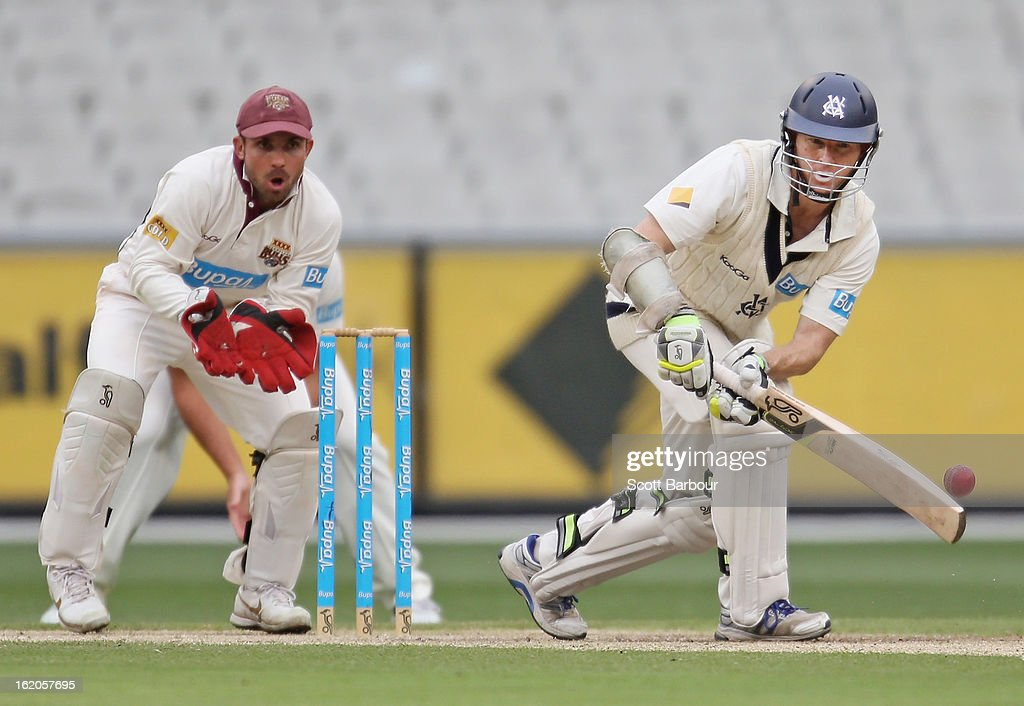 Chris Rogers of Victoria bats as wicketkeeper Chris Hartley of the Bulls looks on during day two of the Sheffield Shield match between the Victorian Bushrangers and Queensland Bulls at Melbourne Cricket Ground on February 19, 2013 in Melbourne, Australia.