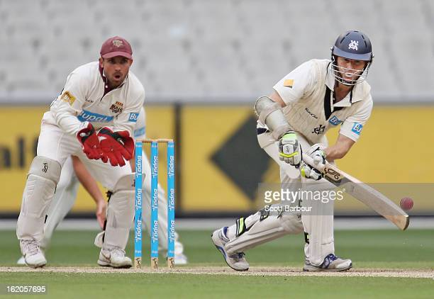 Chris Rogers of Victoria bats as wicketkeeper Chris Hartley of the Bulls looks on during day two of the Sheffield Shield match between the Victorian...