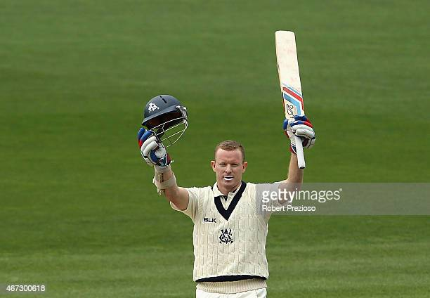 Chris Rogers of Victoria celebrates after scoring his century during day three of the Sheffield Shield final match between Victoria and Western...