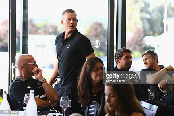 Chris Rogers the captain of Somerset looks on at the television screen alongside Director of Cricket Matthew Maynard as Middlesex take the final...