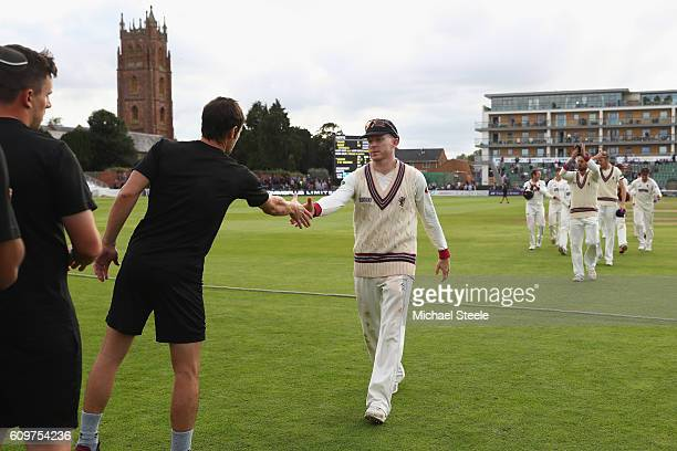 Chris Rogers the captain of Somerset shakes hands with his counterpart Chris Read of Nottinghamshire concluding his sides 325 run victory during day...