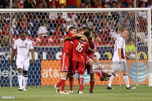 Chris Rolfe and teammates of Chicago Fire celebrate after kicking the goal against the Real Salt Lake at Rio Tinto Stadium on September 12 2009 in...