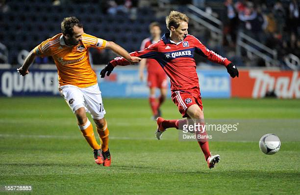 Chris Rolfe of Chicago Fire and Adam Moffat of Houston Dynamo go after the ball in an MLS match on October 31 2012 at Toyota Park in Bridgeview...