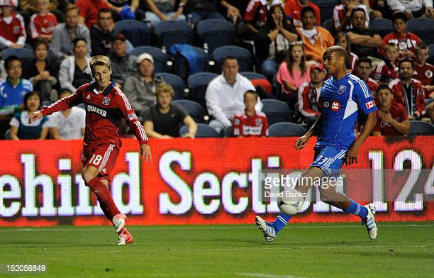 Chris Rolfe of Chicago Fire and Matteo Ferrari of Montreal Impact vie for the ball in an MLS match on September 15 2012 at Toyota Park in Bridgeview...