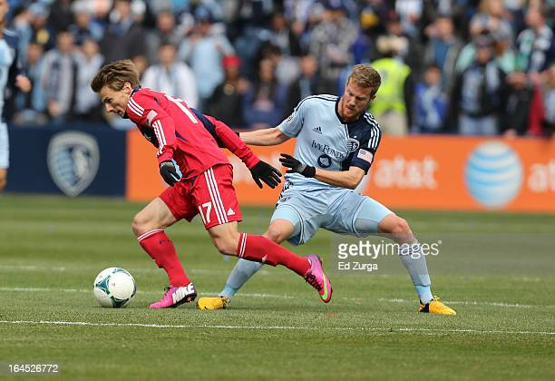 Chris Rolfe of Chicago Fire and Oriol Rosell of Sporting Kansas City battle for the ball at Sporting Park on March 16 2013 in Kansas City Kansas