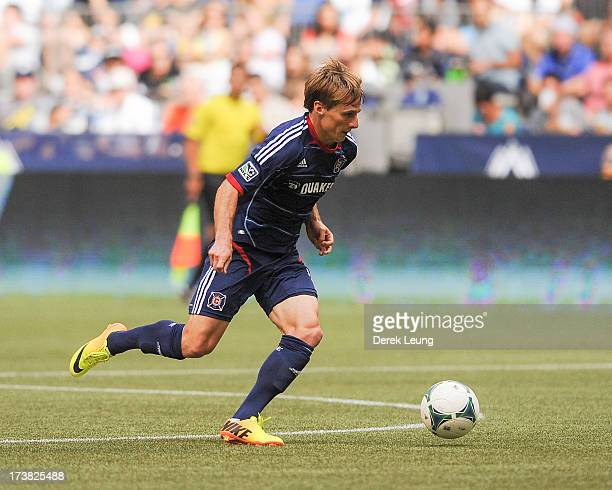 Chris Rolfe of Chicago Fire in action during an MLS match against the Vancouver Whitecaps at BC Place on July 14 2013 in Vancouver British Columbia...