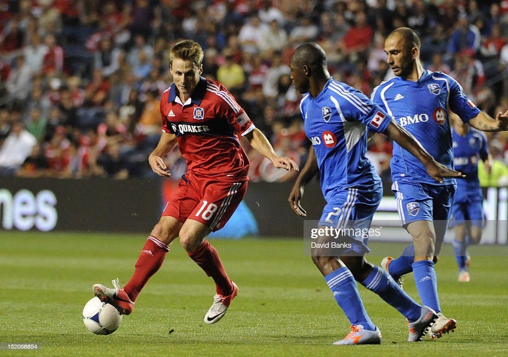 Chris Rolfe #18 of Chicago Fire is defended by Nelson Rivas #2 of Montreal Impact in an MLS match on September 15, 2012 at Toyota Park in Bridgeview, Illinois.