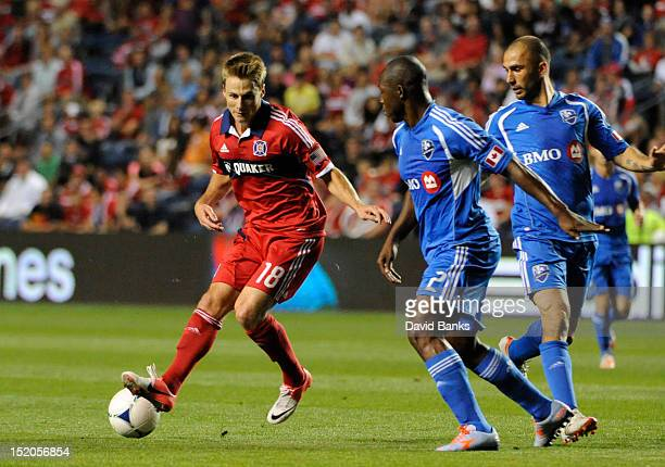 Chris Rolfe of Chicago Fire is defended by Nelson Rivas of Montreal Impact in an MLS match on September 15 2012 at Toyota Park in Bridgeview Illinois