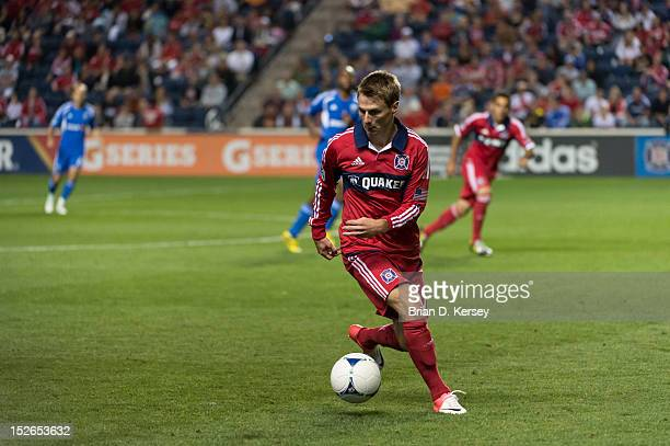 Chris Rolfe of Chicago Fire moves the ball against the Montreal Impact at Toyota Park on September 15 2012 in Bridgeview Illinois The Fire defeated...