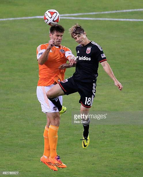 Chris Rolfe of DC United and David Horst of Houston Dynamo go up for the ball during the second half at RFK Stadium on May 21 2014 in Washington DC