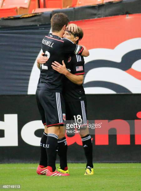 Chris Rolfe of DC United celebtrates after scoring a goal against the Houston Dynamo with teammate Bobby Boswell during the first half at RFK Stadium...