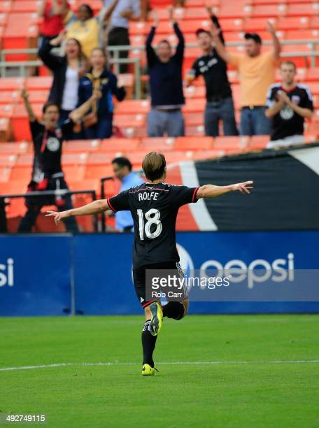 Chris Rolfe of DC United celebtrates after scroing a goal against the Houston Dynamo during the first half at RFK Stadium on May 21 2014 in...