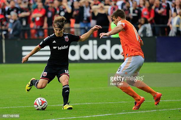 Chris Rolfe of DC United dribbles around and scores a goal on David Horst of Houston Dynamo during the first half at RFK Stadium on May 21 2014 in...