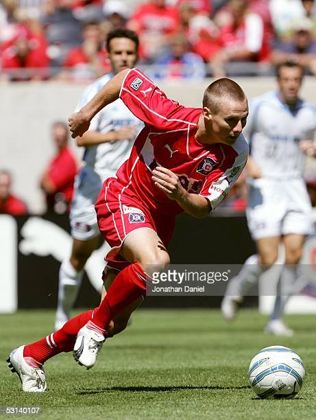 Chris Rolfe of the Chicago Fire advances the ball against the Kansas City Wizards during their MLS game on June 18 2005 at Soldier Field in Chicago...