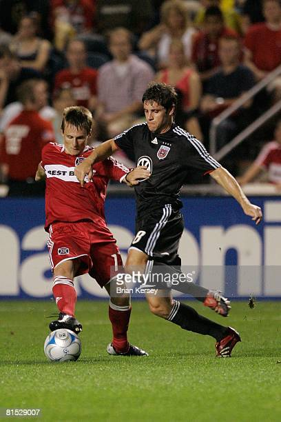 Chris Rolfe of the Chicago Fire and Devon McTavish of DC United go for the ball during the second half at Toyota Park on June 7 2008 in Bridgeview...