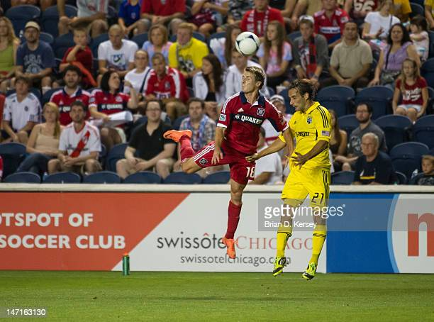 Chris Rolfe of the Chicago Fire and Sebastian Miranda of the Columbus Crew go for the ball at Toyota Park on June 23 2012 in Bridgeview Illinois The...