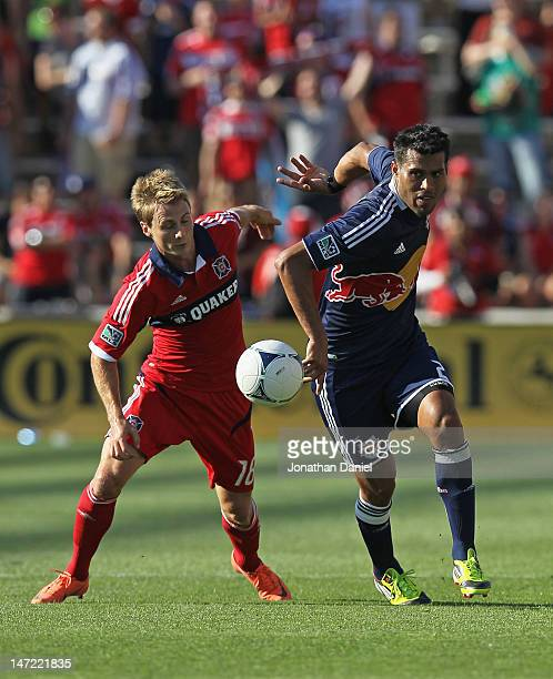 Chris Rolfe of the Chicago Fire and Wilman Conde of the New York Red Bulls battle for the ball during an MLS match at Toyota Park on June 17 2012 in...