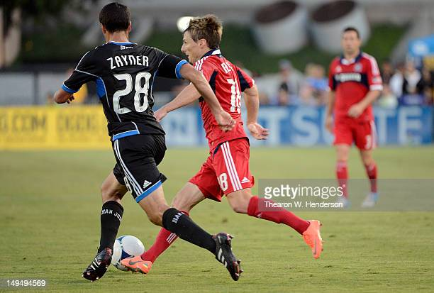 Chris Rolfe of the Chicago Fire attacks the goal dribbling the ball away from Jed Zayner of the San Jose Earthquakes during the first half of an MLS...