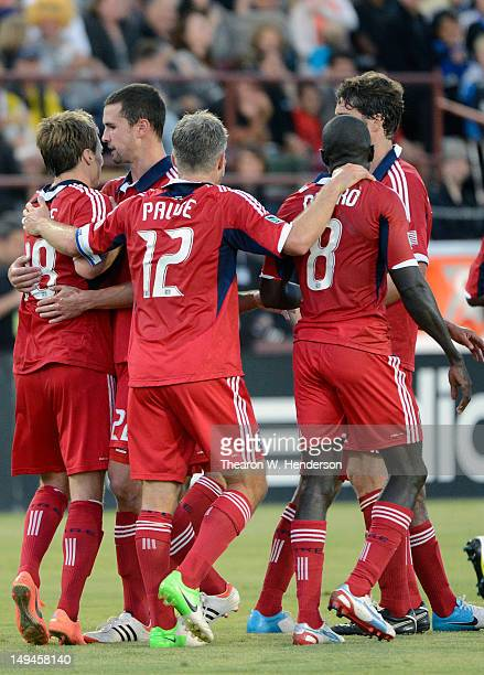 Chris Rolfe of the Chicago Fire celebrates with teammates Logan Pause and Dominic Oduro after Rolfe scored a goal against the San Jose Earthquakes in...
