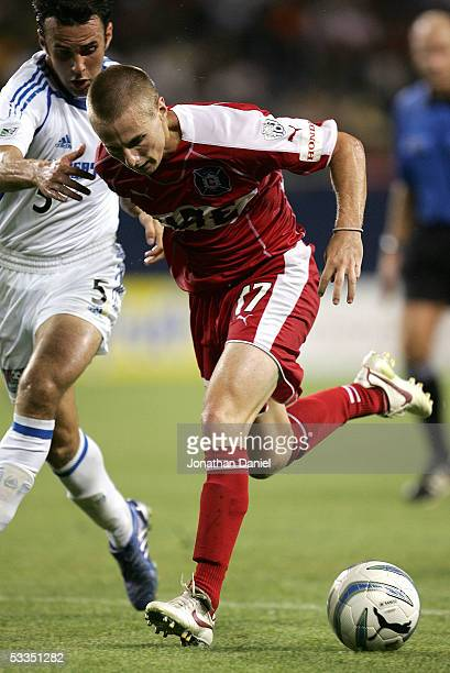 Chris Rolfe of the Chicago Fire charges toward the goal under pressure from Kerry Zavagnin of the Kansas City Wizards on August 10 2005 at Soldier...
