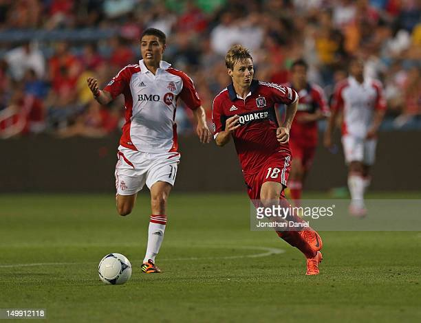 Chris Rolfe of the Chicago Fire chases the ball in front of Luis Silva of Toronto FC during an MLS match at Toyota Park on August 4 2012 in...