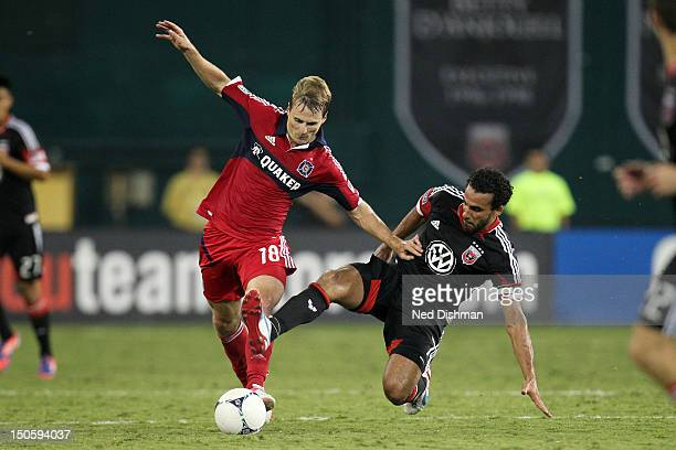 Chris Rolfe of the Chicago Fire competes for the ball with Dwayne De Rosario of DC United at RFK Stadium on August 22 2012 in Washington DC