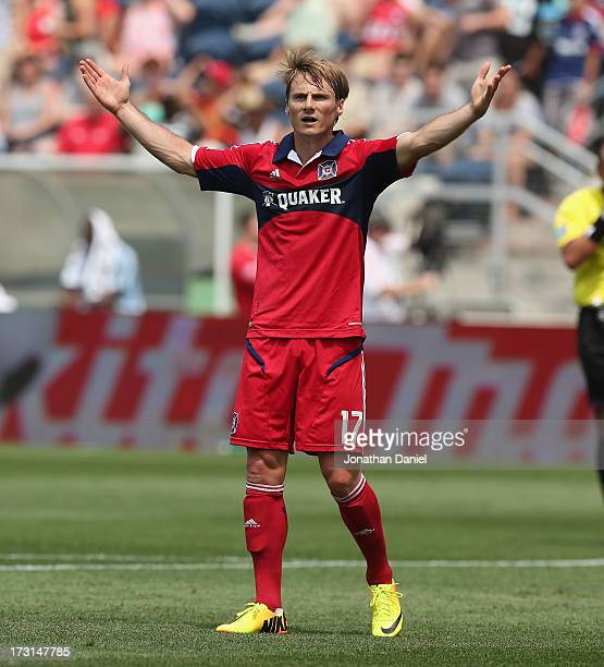 Chris Rolfe of the Chicago Fire complains to an official against Sporting Kansas City during an MLS match at Toyota Park on July 7 2013 in Bridgeview...