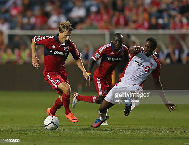 Chris Rolfe of the Chicago Fire controls the ball past Ryan Johnson of Toronto FC during an MLS match at Toyota Park on August 4 2012 in Bridgeview...