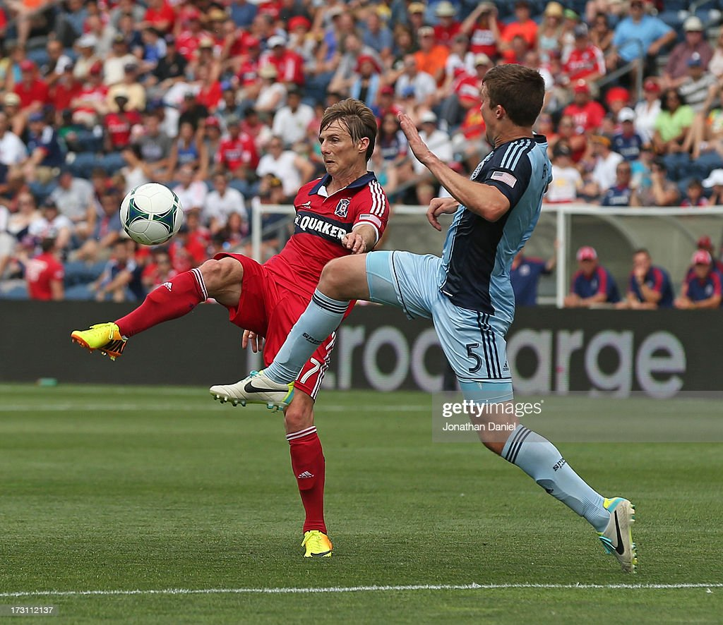 Chris Rolfe #17 of the Chicago Fire controls the ball under pressure from Matt Besler #5 of Sporting Kansas City during an MLS match at Toyota Park on July 7, 2013 in Bridgeview, Illinois.