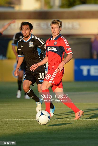 Chris Rolfe of the Chicago Fire dribbles the ball away from Rafael Baca of the San Jose Earthquakes at Buck Shaw Stadium on July 28 2012 in Santa...