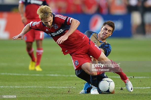Chris Rolfe of the Chicago Fire is tripped up by Michael Farfan of the Philadelphia Union at PPL Park on August 12 2012 in Chester Pennsylvania
