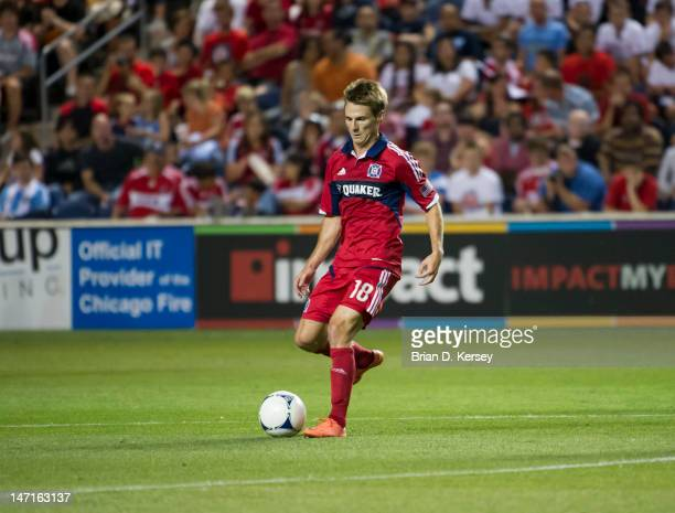 Chris Rolfe of the Chicago Fire moves the ball against the Columbus Crew at Toyota Park on June 23 2012 in Bridgeview Illinois The Fire defeated the...