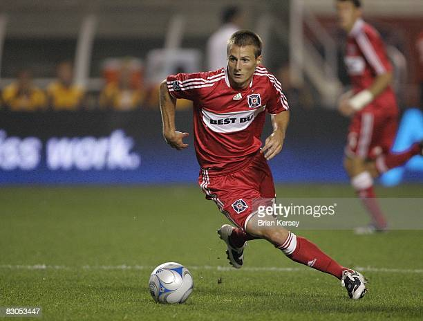 Chris Rolfe of the Chicago Fire moves the ball against the Los Angeles Galaxy during the second half at Toyota Park on September 25 2008 in...